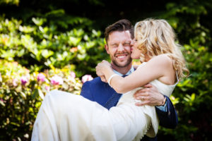 Wedding Photography Scotland Groom Holding his Wife and Kissing