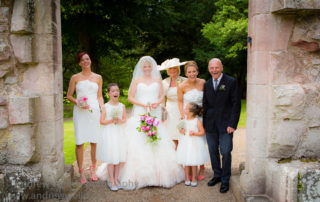Wedding Photography Scotland Bride with Bridesmaids and Father in Dryburgh Abbey