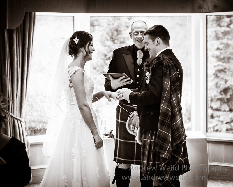 Wedding Photography Scotland Groom Putting the Ring On the Bride Falkirk
