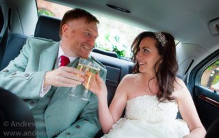 Wedding Photography Scotland Newlyweds Toasting with champagne in the car